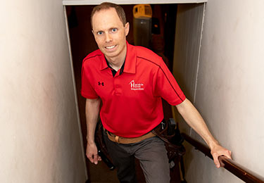 Home inspector David Bugenhagen inspecting a basement.